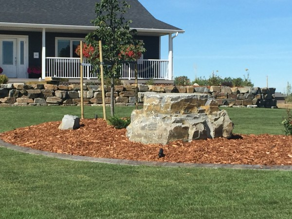 Natural Stone Retaining Wall and Feature Boulder